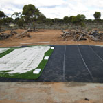 Cushion and grass panels being installed