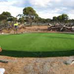 Attaching fringe grass to the green